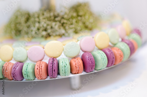 Traditional macarons on a glass cake stand