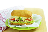 Sub sandwich on chopping board