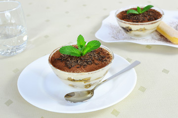 Tiramisu in glass bowl - closeup