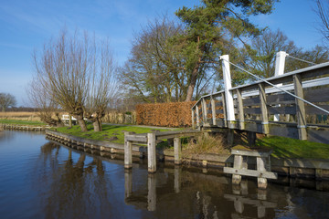 Wooden bridge over a canal in winter