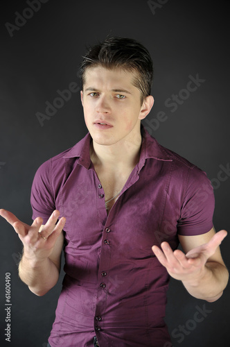 Handsome man gesturing with his hands