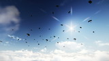 Flying across multiple paratroopers descending from the sky