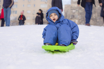 young boy on sledge