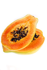 two halves of fresh papaya isolated on white