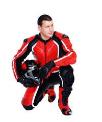 motorcyclis tstanding on his knee