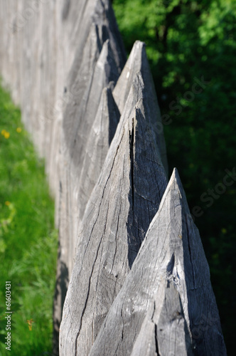 sharp wooden paling as part of old fort