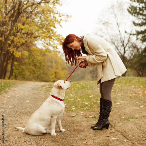 Beautiful women training her dog