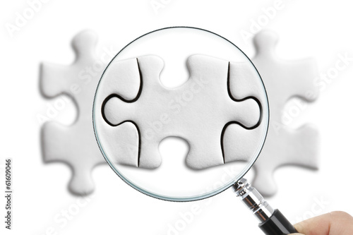 Puzzle Piece with magnifying glass