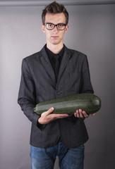 vegetarian vegetable businessman holds in hands