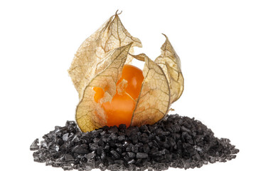 Physalis fruit on black salt