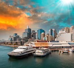 Sydney. Aquarium Ferry Wharf and city skyline at dusk