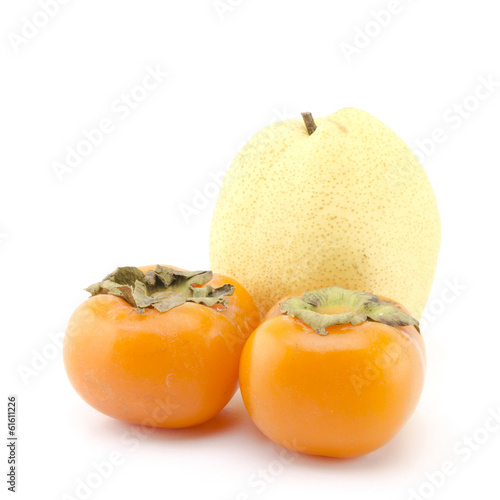 chinese pear and two persimons isolated on white