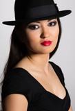 Charming young woman Asian in hat
