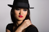 Beautiful Asian girl in a black hat