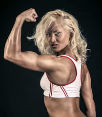 Athlete showing her biceps
