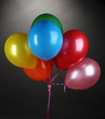 bright balloons on gray background