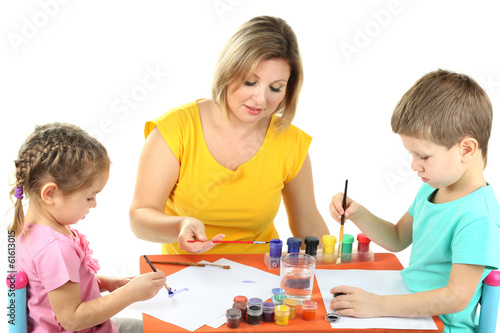 Little children drawing with mom isolated on white