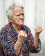 Old woman making fists