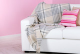 White sofa in room on pink wall background
