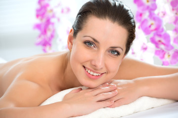 Beautiful woman in spa environment