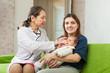 pediatrician doctor examining newborn baby