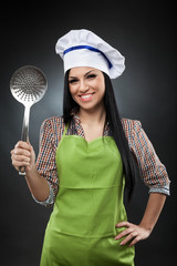 Hispanic cook with skimmer