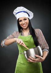 Hispanic woman cook with pot