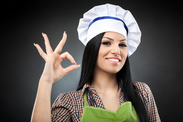 Hispanic woman cook making ok sign