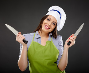 Woman chef holding two knives