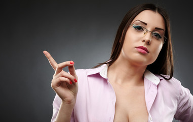 Sexy teacher wearing glasses and showing her finger