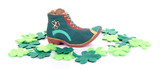 Saint Patrick day boot with gold and clover leaves, isolated