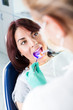 Dental treatment with UV lamp