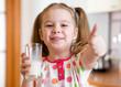 Kid drinking milk from glass