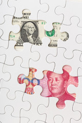 US and Chinese currency as part of puzzle