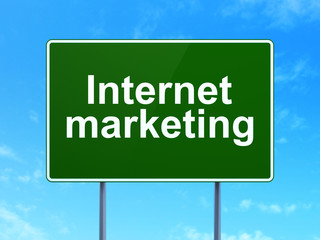Advertising concept: Internet Marketing on road sign background