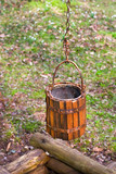 antique wood-paneled Pit bucket