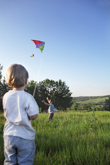 two happy boy with kite