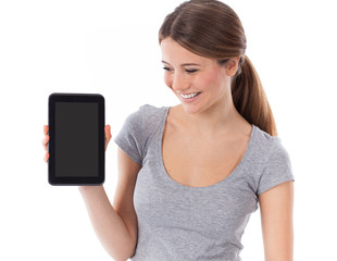 Young woman showing tablet pc