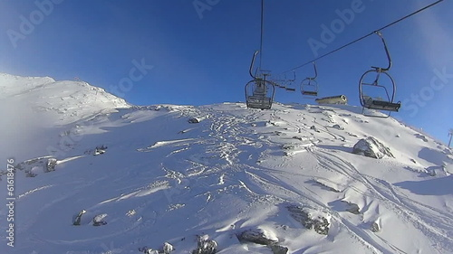 Ski lift chairs on hillside, Zillertal, Austria, time lapse