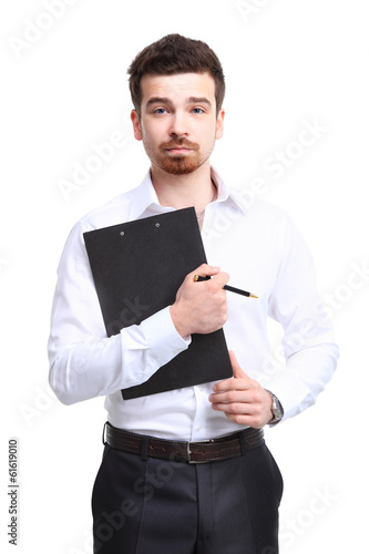 Portrait of cheerful businessman making notes
