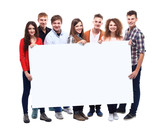 group of smiling friends holding blank banner