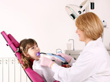 female dentist and little girl healthcare