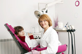 little girl and female dentist in dental practice