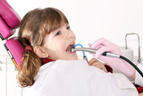 little girl with open mouth during drilling treatment at the den