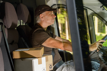 Courier man driving cargo car delivering package
