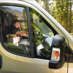 Courier man driving car delivering postal package