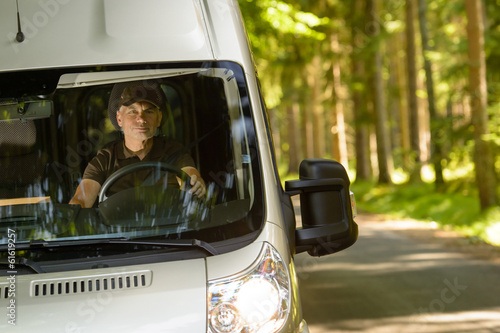 Delivery courier in van on the way