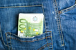 Pants jeans with euro banknotes in the pocket