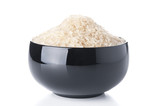 Raw rice in a black bowl