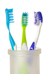 Tooth-brushes on white background